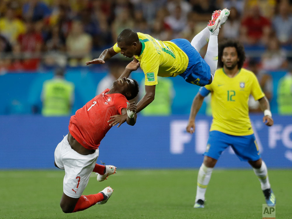Switzerland's Breel Embolo, left, and Brazil's Fernandinho fall during the group E match between Brazil and Switzerland at the 2018 soccer World Cup in the Rostov Arena in Rostov-on-Don, Russia, Sunday, June 17, 2018. (AP Photo/Andre Penner)