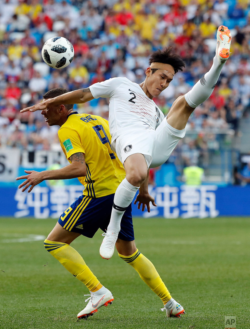 South Korea's Lee Yong is challenged by Sweden's Marcus Berg during the group F match between Sweden and South Korea at the 2018 soccer World Cup in the Nizhny Novgorod stadium in Nizhny Novgorod, Russia, Monday, June 18, 2018. (AP Photo/Pavel Golovkin)