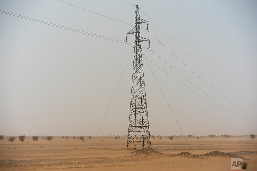 An electricity pylon stands in Niger's Tenere desert region of the south central Sahara on May 30, 2018. (AP Photo/Jerome Delay)