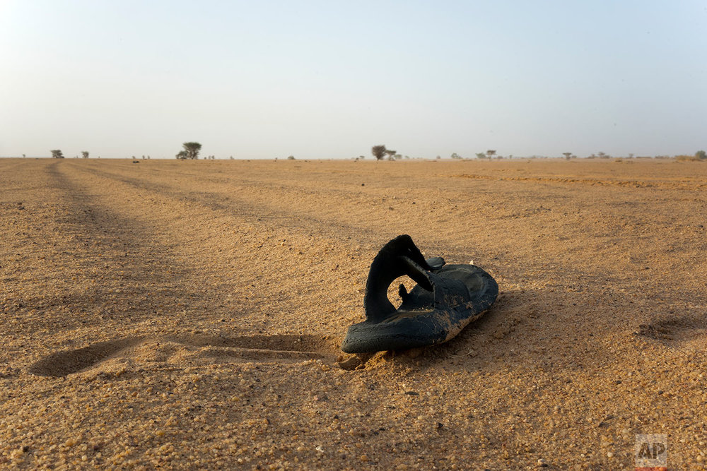 A sandal rests in Niger's Tenere desert region of the south central Sahara on June 3, 2018. (AP Photo/Jerome Delay)