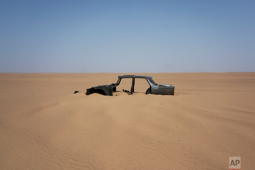 The frame of an abandoned Peugeot 404 rests in Niger's Tenere desert region of the south central Sahara on June 3, 2018. (AP Photo/Jerome Delay)