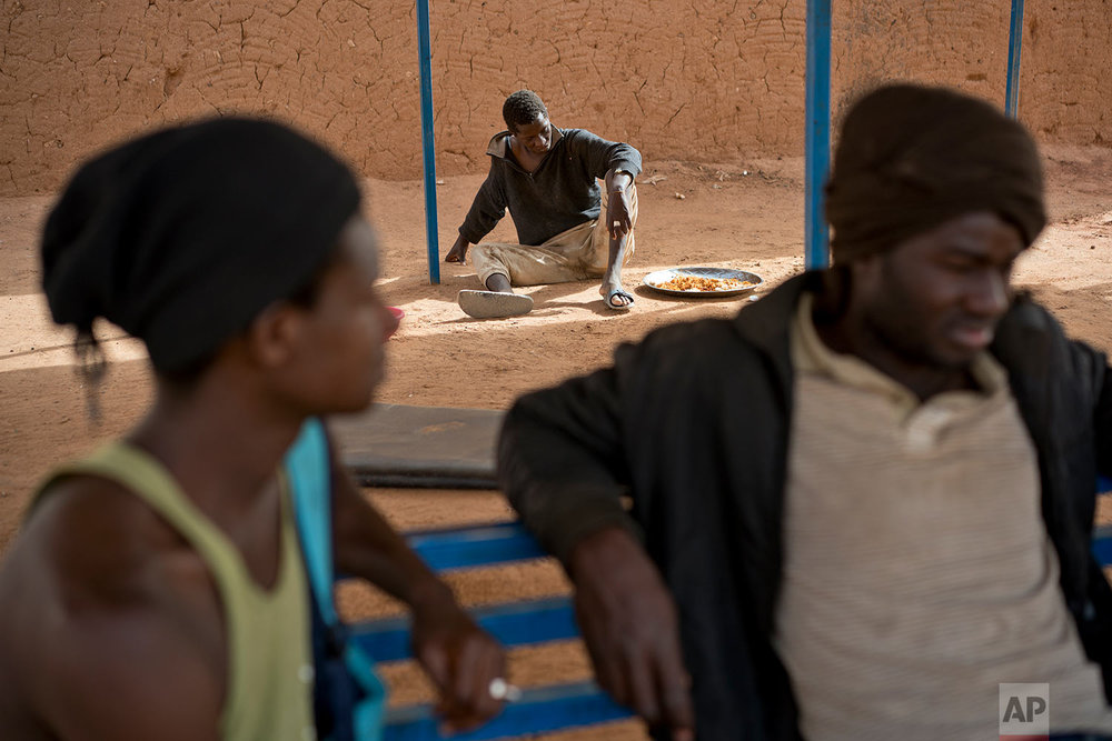 A young migrant who has been expelled from Algeria sits in a transit center in Arlit, Niger, on June 1,2018. (AP Photo/Jerome Delay)