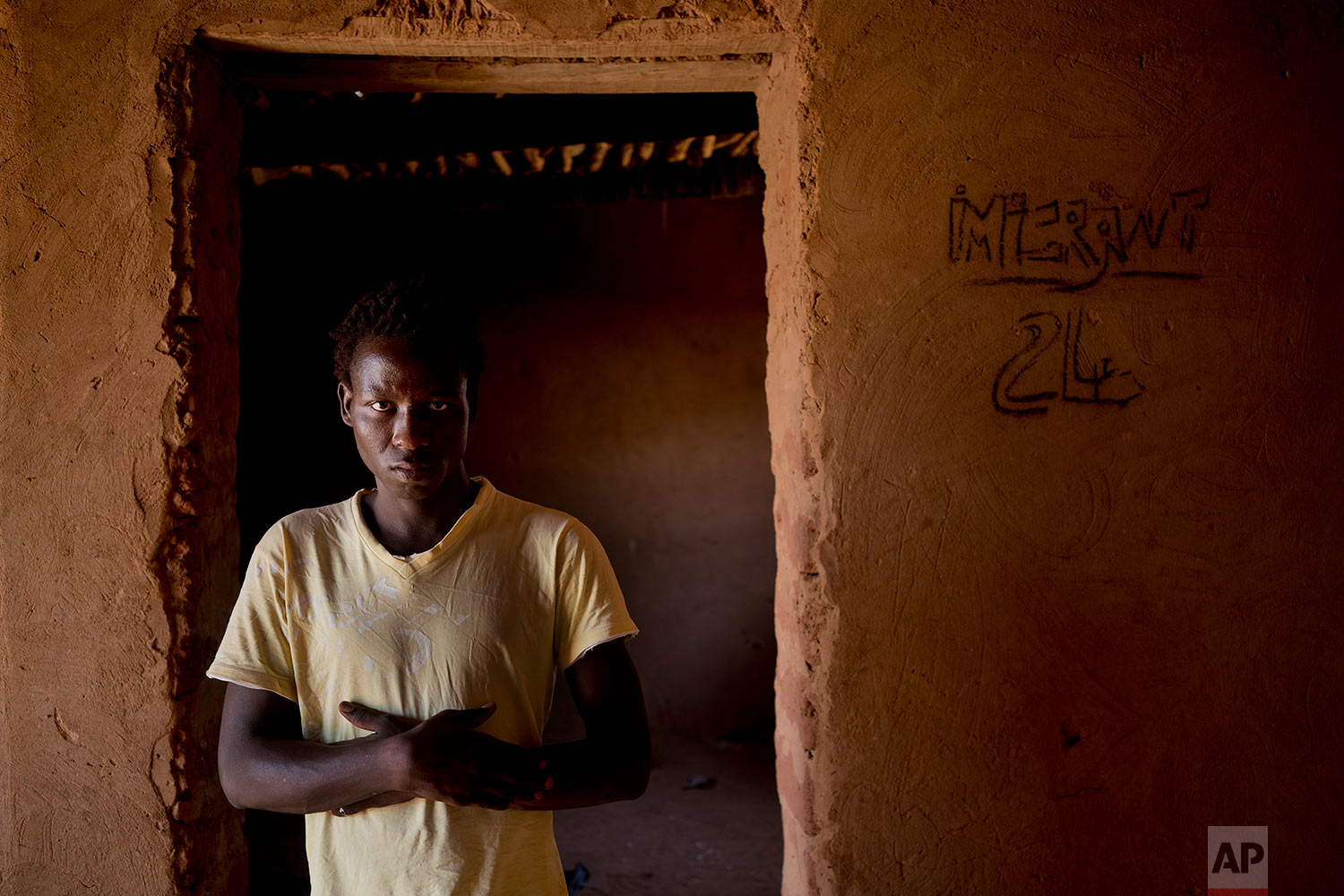 Aliou Kande poses for a photograph in an IOM transit camp in Arlit, Niger, on May 31, 2018. (AP Photo/Jerome Delay)