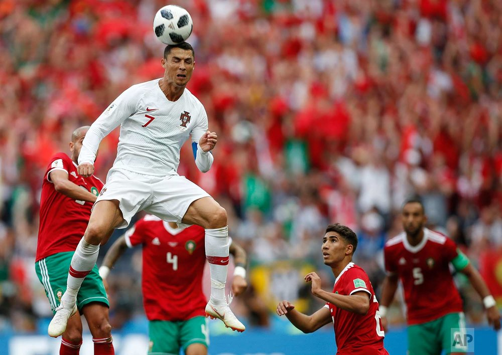 Portugal's Cristiano Ronaldo leaps up for a header during the group B match between Portugal and Morocco at the 2018 soccer World Cup in the Luzhniki Stadium in Moscow, Russia, Wednesday, June 20, 2018. (AP Photo/Francisco Seco)