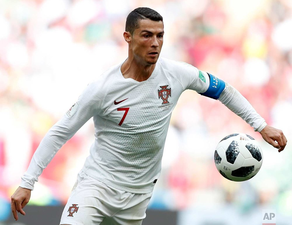 Portugal's Cristiano Ronaldo goes for the ball during the group B match between Portugal and Morocco at the 2018 soccer World Cup in the Luzhniki Stadium in Moscow, Russia, Wednesday, June 20, 2018. (AP Photo/Francisco Seco)