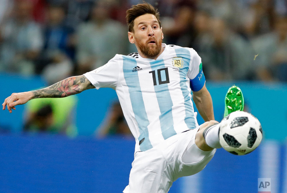Argentina's Lionel Messi reaches for the ball during the group D match between Argentina and Croatia at the 2018 soccer World Cup in Nizhny Novgorod Stadium in Nizhny Novgorod, Russia, Thursday, June 21, 2018. (AP Photo/Ricardo Mazalan)