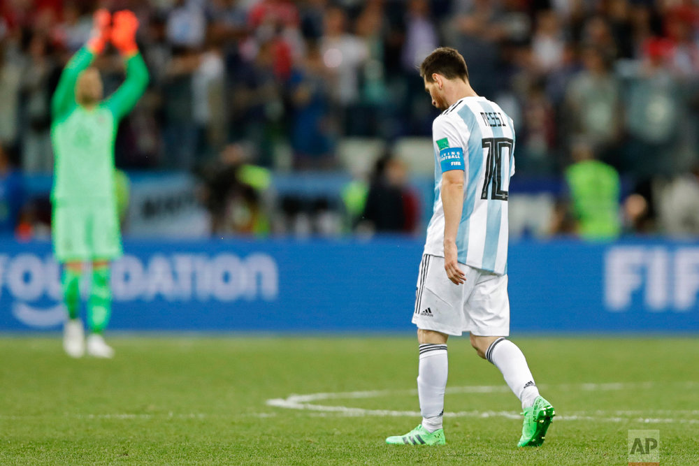 Argentina's Lionel Messi walks along the pitch at the end of the group D match between Argentina and Croatia at the 2018 soccer World Cup in Nizhny Novgorod Stadium in Nizhny Novgorod, Russia, Thursday, June 21, 2018. Croatia defeated Argentina 3-0. (AP Photo/Ricardo Mazalan)