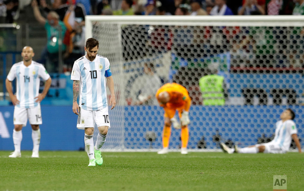 Argentina's Lionel Messi, foreground, looks down as he walks on the pitch after the group D match between Argentina and Croatia at the 2018 soccer World Cup in Nizhny Novgorod Stadium in Nizhny Novgorod, Russia, Thursday, June 21, 2018. Croatia won 3-0. (AP Photo/Petr David Josek)