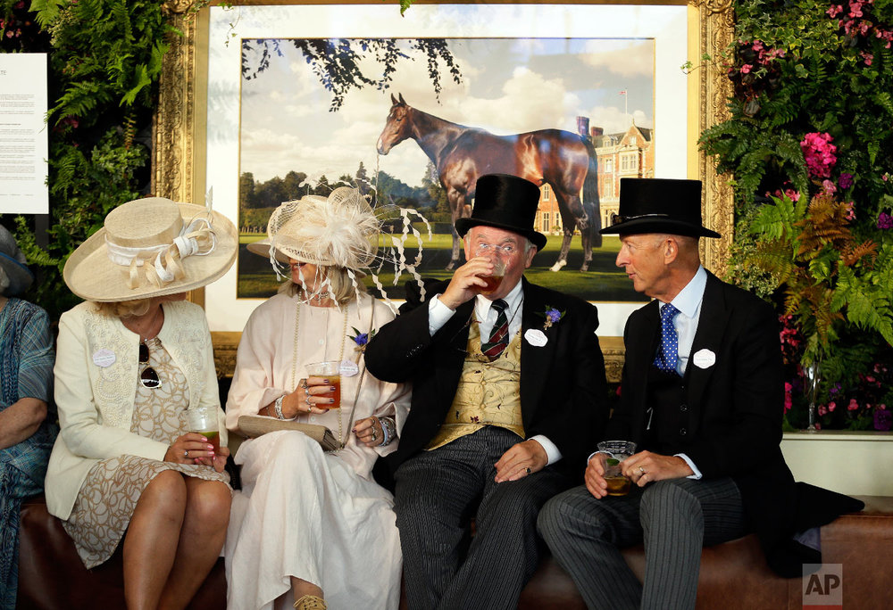 Racegoers enjoy a drink on the first day of the Royal Ascot horse race meeting in Ascot, England, Tuesday, June 19, 2018. (AP Photo/Tim Ireland)