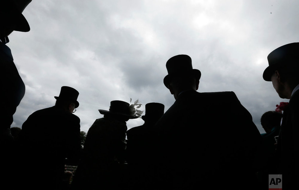 Racegoers on the first day of the Royal Ascot horse race meeting in Ascot, England, Tuesday, June 19, 2018. (AP Photo/Tim Ireland)