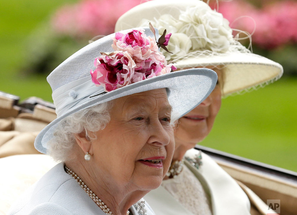 Britain's Queen Elizabeth II arrives at the parade ring with Princess Alexandra in a horse drawn carriage, on the second day of the Royal Ascot horse race meeting in Ascot, England, Wednesday, June 20, 2018. (AP Photo/Tim Ireland)
