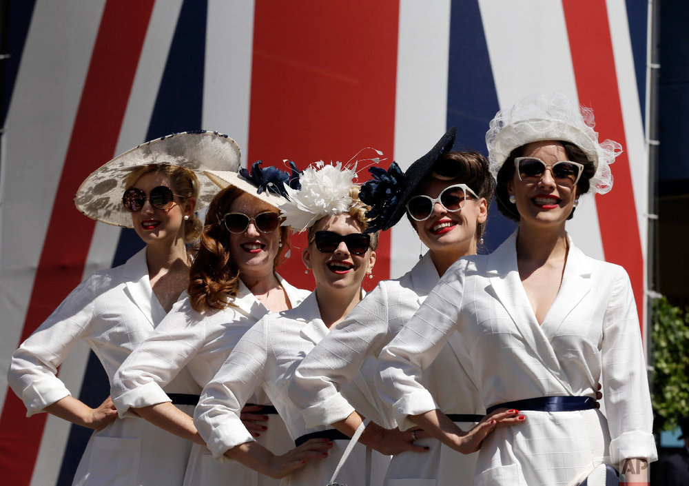 The Tootsie Rollers pose for the media on the third day of the Royal Ascot horse race meeting, which is traditionally known as Ladies Day, in Ascot, England Thursday, June 21, 2018. (AP Photo/Tim Ireland)