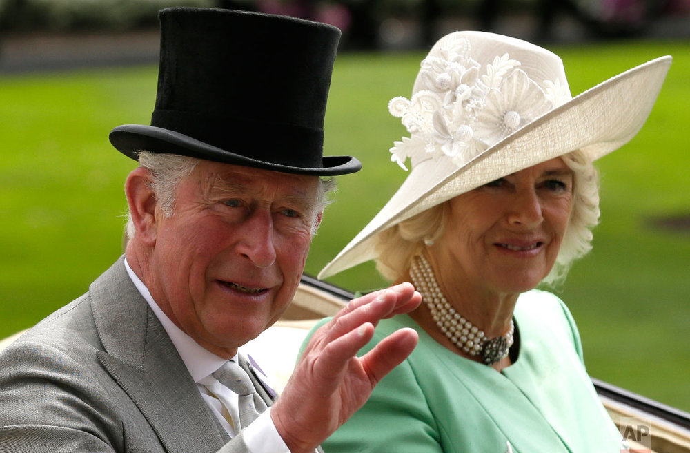 The Prince of Wales and the Duchess of Cornwal arrive at the parade ring in a horse drawn carriage, on the second day of the Royal Ascot horse race meeting in Ascot, England, Wednesday, June 20, 2018. (AP Photo/Tim Ireland)