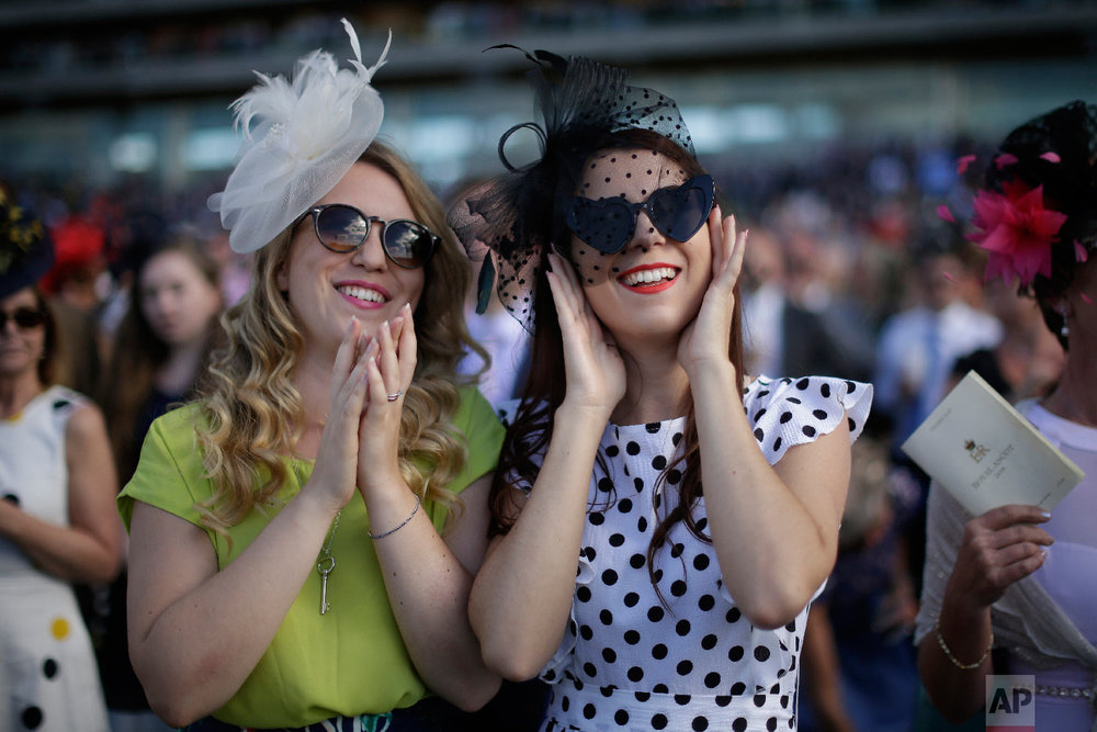 Racegoers watch the fifth and final race on the third day of the Royal Ascot horse race meeting, which is traditionally known as Ladies Day, in Ascot, England Thursday, June 21, 2018. (AP Photo/Tim Ireland)
