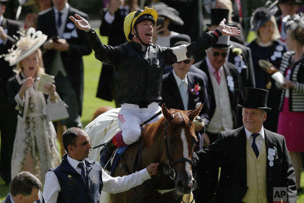 Frankie Dettori riding Stradivarius celebrates winning the Gold Cup on the third day of the Royal Ascot horse race meeting, which is traditionally known as Ladies Day, in Ascot, England Thursday, June 21, 2018. (AP Photo/Tim Ireland)