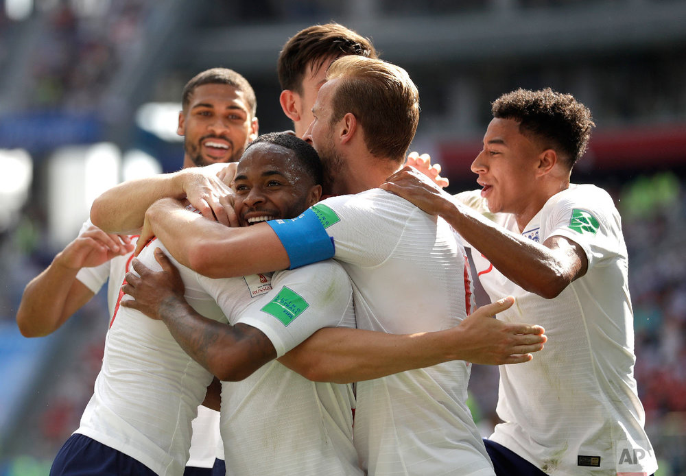 England's John Stones is congratulated by teammates after scoring his team's fourth goal during the group G match between England and Panama at the 2018 soccer World Cup at the Nizhny Novgorod Stadium in Nizhny Novgorod, Russia, Sunday, June 24, 2018. (AP Photo/Matthias Schrader)
