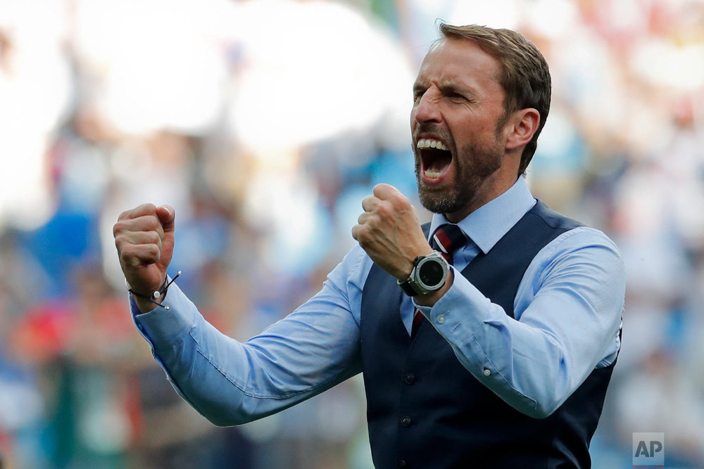 England head coach Gareth Southgate celebrates his team's 6-1 victory at the end of the group G match between England and Panama at the 2018 soccer World Cup at the Nizhny Novgorod Stadium in Nizhny Novgorod , Russia, Sunday, June 24, 2018. (AP Photo/Antonio Calanni)