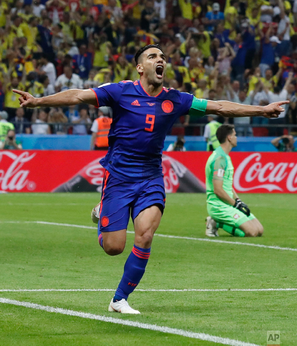 Colombia's Radamel Falcao celebrates after scoring the second side goal past Poland goalkeeper Wojciech Szczesny during the group H match between Poland and Colombia at the 2018 soccer World Cup at the Kazan Arena in Kazan, Russia, Sunday, June 24, 2018. (AP Photo/Frank Augstein)