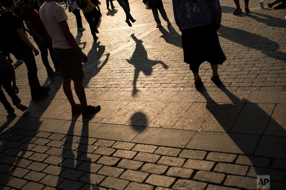 People play with a soccer ball during the 2018 soccer World Cup at the Manezhnaya Square in central Moscow, Russia on Tuesday, June 19, 2018. (AP Photo/Francisco Seco)