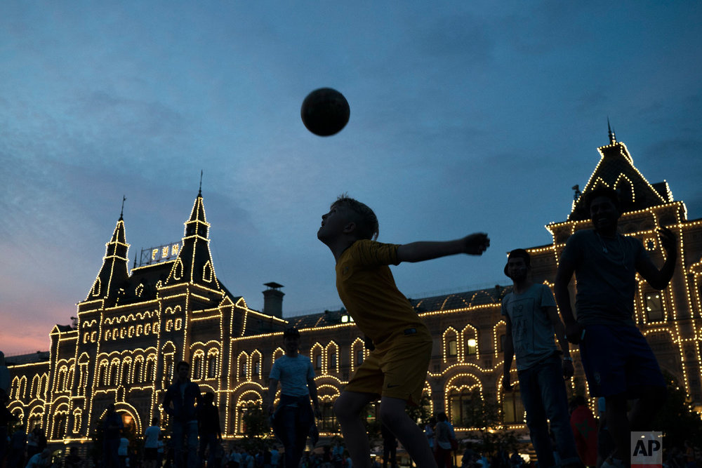 People play soccer at the Red Square during the 2018 soccer World Cup in Moscow, Russia on June 19, 2018. (AP Photo/Felipe Dana)