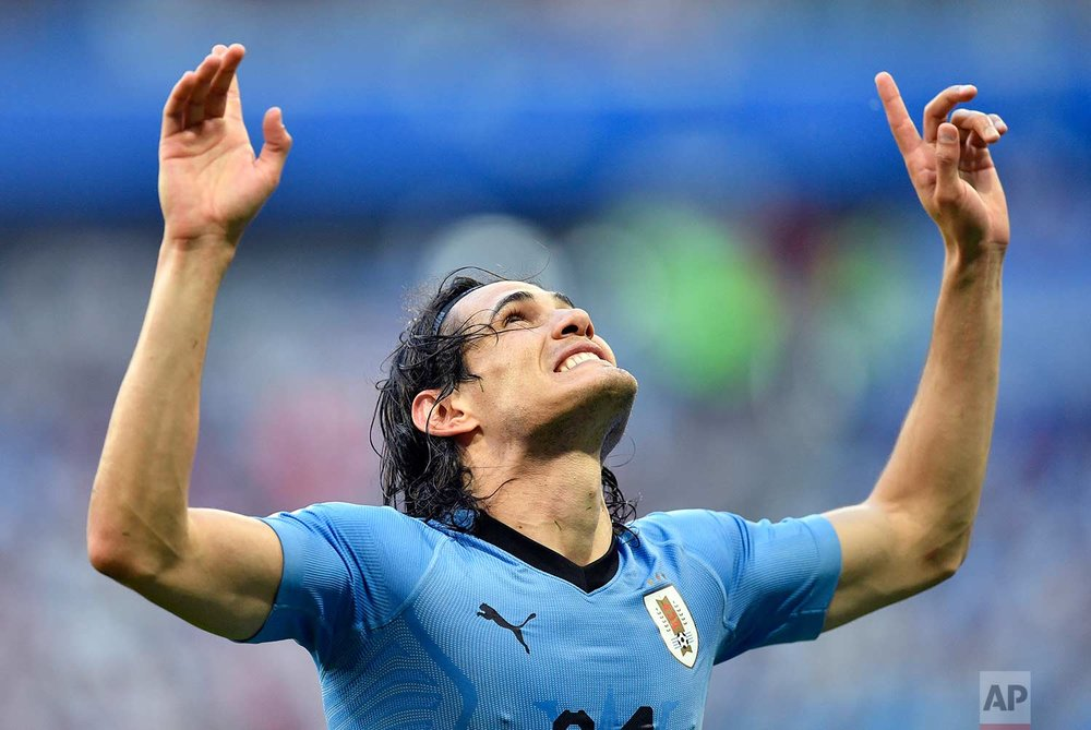 Uruguay's Edinson Cavani celebrates after scoring his team's third goal during the group A match between Uruguay and Russia at the 2018 soccer World Cup at the Samara Arena in Samara, Russia, Monday, June 25, 2018. (AP Photo/Martin Meissner)