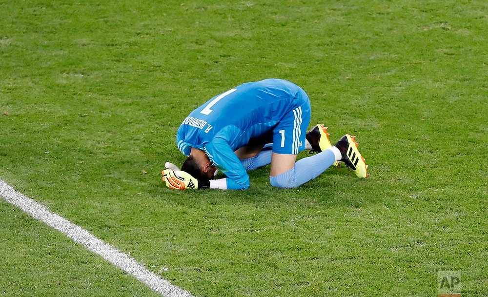 Iran goalkeeper Ali Beiranvand reacts at the end of the group B match between Iran and Portugal at the 2018 soccer World Cup at the Mordovia Arena in Saransk, Russia, Monday, June 25, 2018. (AP Photo/Darko Bandic)