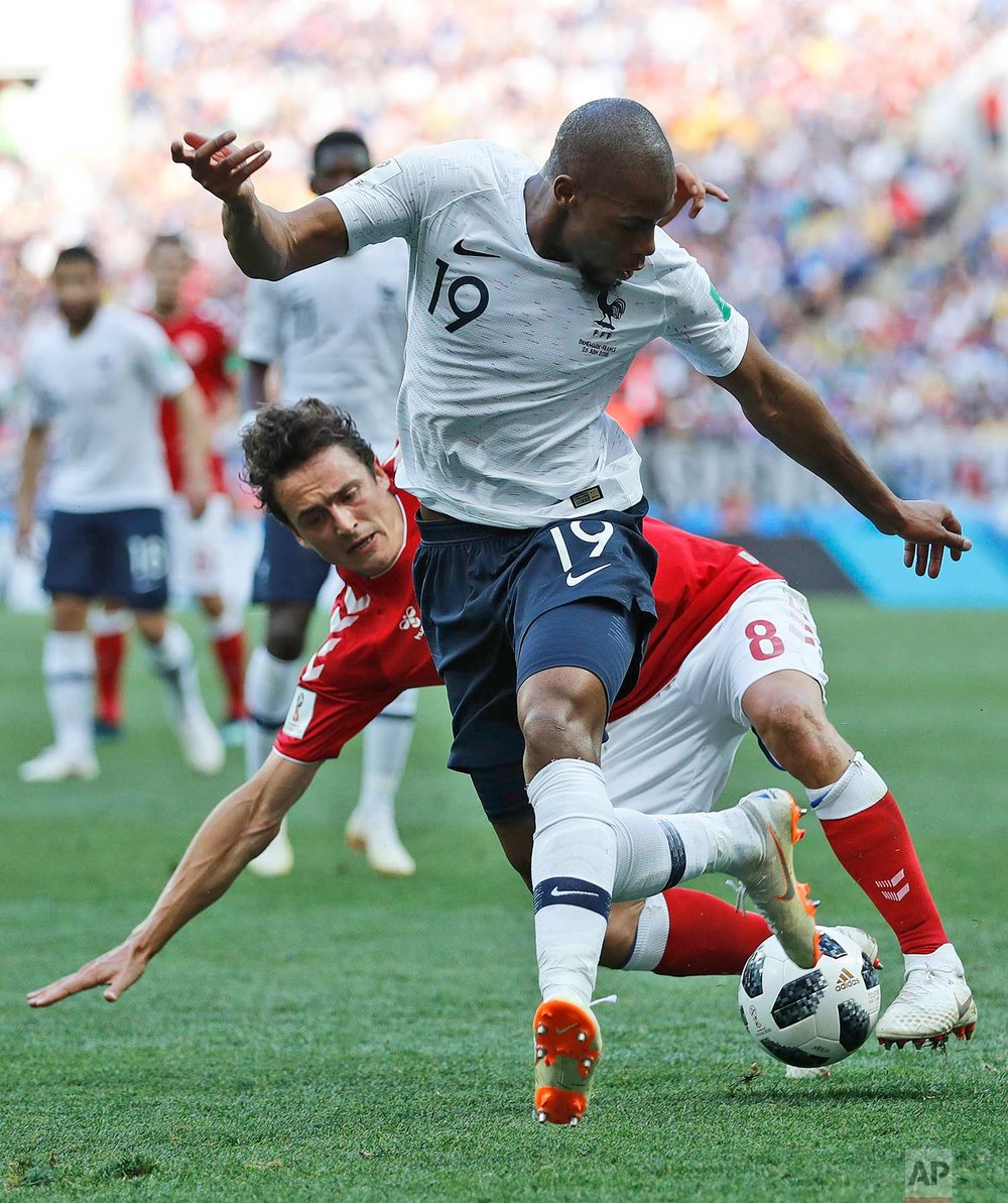 France's Djibril Sidibe, front, and Denmark's Thomas Delaney challenge for the ball during the group C match between Denmark and France at the 2018 soccer World Cup at the Luzhniki Stadium in Moscow, Russia, Tuesday, June 26, 2018. (AP Photo/David Vincent)