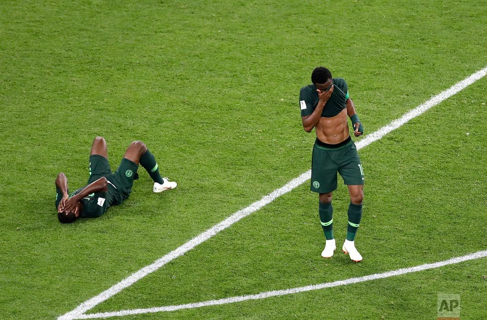 Nigeria players react at the end of the group D match between Argentina and Nigeria, at the 2018 soccer World Cup in the St. Petersburg Stadium in St. Petersburg, Russia, Tuesday, June 26, 2018. Argentina won 2-1. (AP Photo/Michael Sohn)