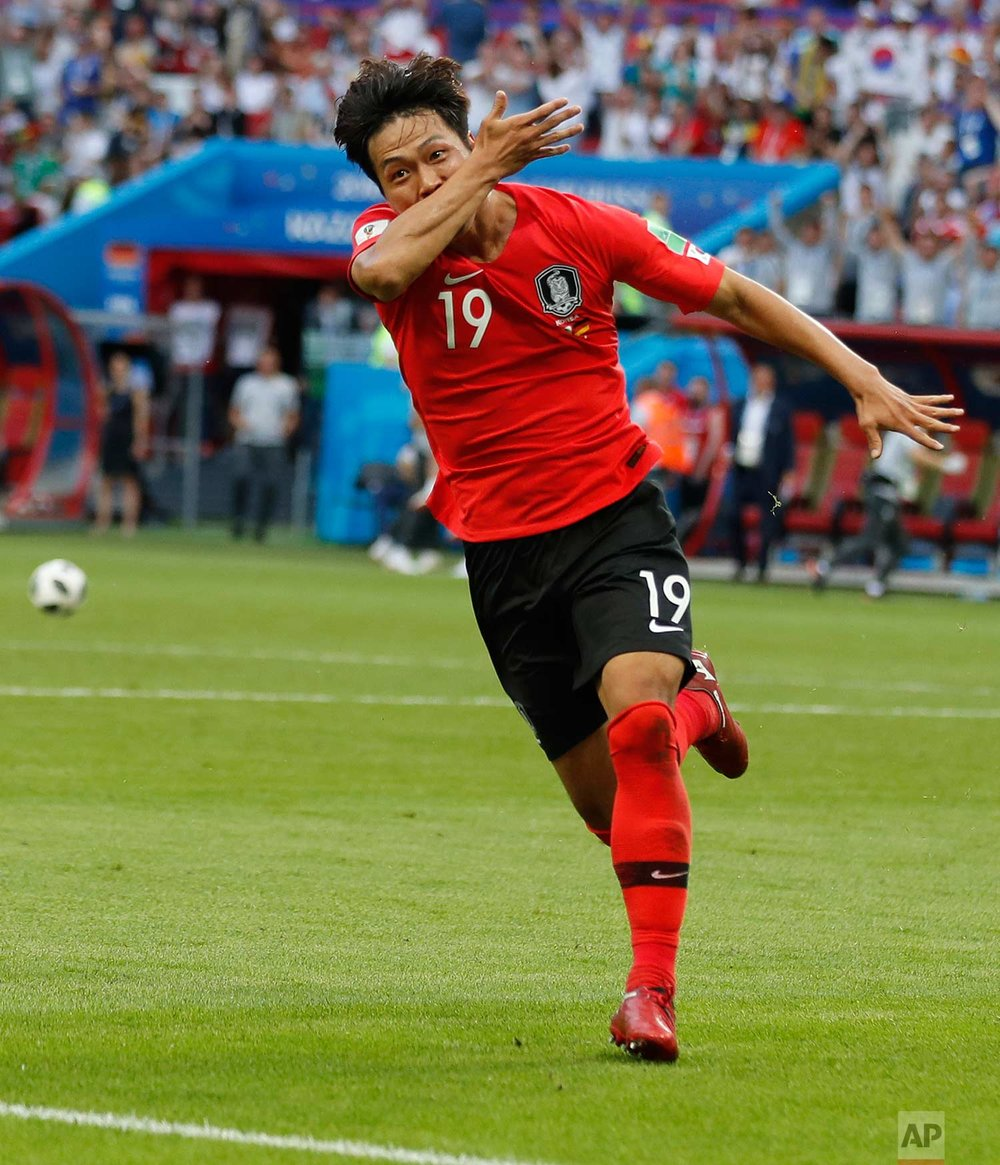 South Korea's Kim Young-gwon celebrates scoring his sides first goal during the group F match between South Korea and Germany, at the 2018 soccer World Cup in the Kazan Arena in Kazan, Russia, Wednesday, June 27, 2018. (AP Photo/Frank Augstein)