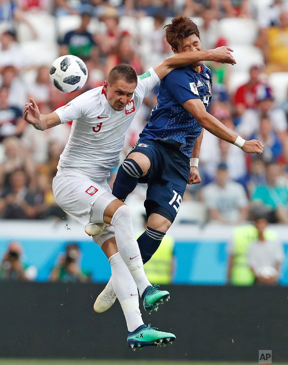 Poland's Artur Jedrzejczyk, left, challenges Japan's Hiroki Sakai during the group H match between Japan and Poland at the 2018 soccer World Cup at the Volgograd Arena in Volgograd, Russia, Thursday, June 28, 2018. (AP Photo/Darko Vojinovic)