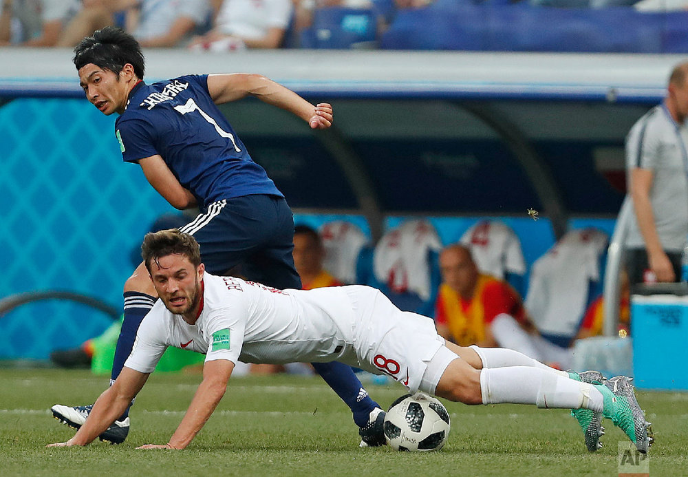 Poland's Bartosz Bereszynski, front, is challenged by Japan's Gaku Shibasaki during the group H match between Japan and Poland at the 2018 soccer World Cup at the Volgograd Arena in Volgograd, Russia, Thursday, June 28, 2018. (AP Photo/Darko Vojinovic)