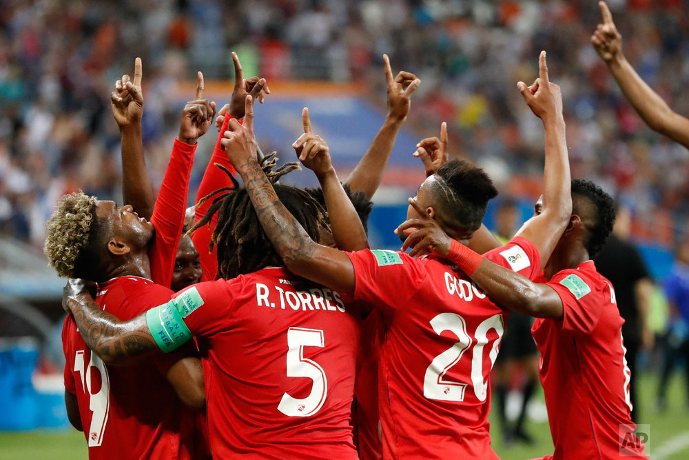 Panama players celebrate after an own goal by Tunisia's Yassine Meriah during the group G match between Panama and Tunisia at the 2018 soccer World Cup at the Mordovia Arena in Saransk, Russia, Thursday, June 28, 2018. (AP Photo/Darko Bandic)