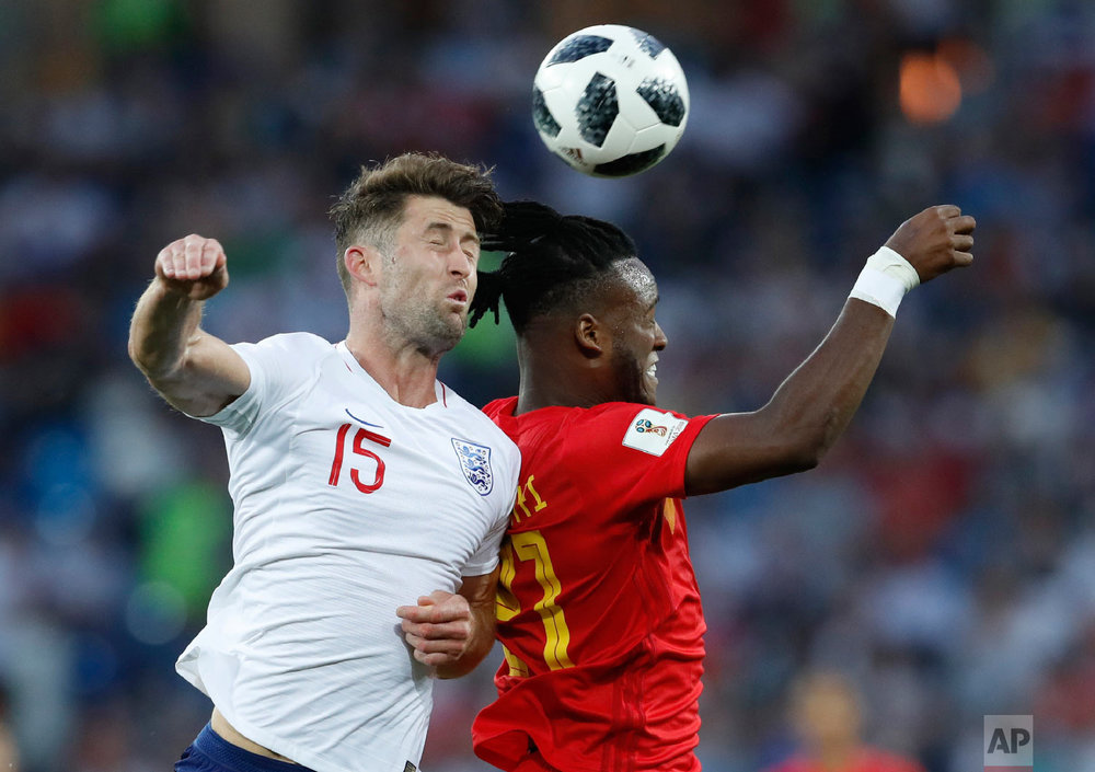 England's Gary Cahill, left, Belgium's Michy Batshuayi challenge for the ball during the group G match between England and Belgium at the 2018 soccer World Cup in the Kaliningrad Stadium in Kaliningrad, Russia, Thursday, June 28, 2018. (AP Photo/Hassan Ammar)
