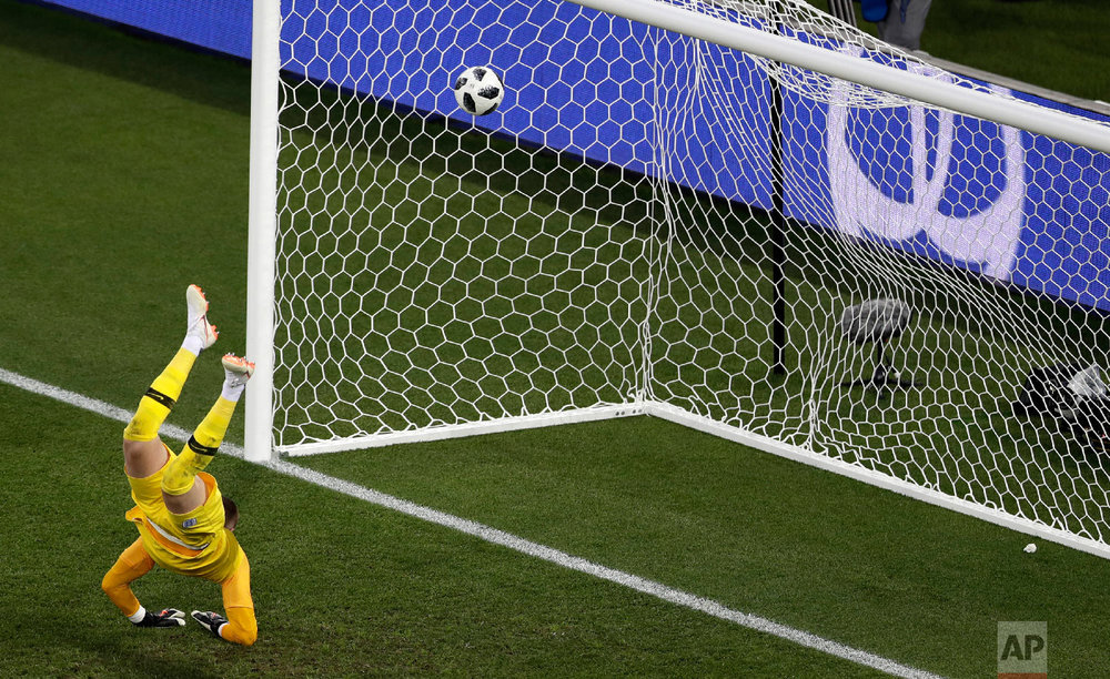 England goalkeeper Jordan Pickford fails to make a save as Belgium's Adnan Januzaj scores the opening goal during the group G match between England and Belgium at the 2018 soccer World Cup in the Kaliningrad Stadium in Kaliningrad, Russia, Thursday, June 28, 2018. (AP Photo/Michael Sohn)