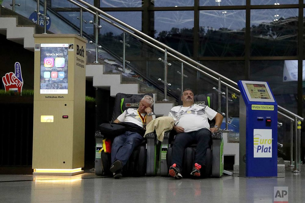 In this Sunday, June 24, 2018 photo, supporters of Germany sleep at Sochi International Airport in Sochi, Russia.  (AP Photo/Thanassis Stavrakis)