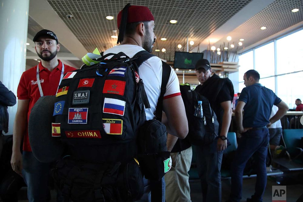 In this Saturday, June 16, 2018 photo, Tunisian fans wait to embark a plane at the Vnukovo International Airport, in Moscow, Russia.  (AP Photo/Thanassis Stavrakis)