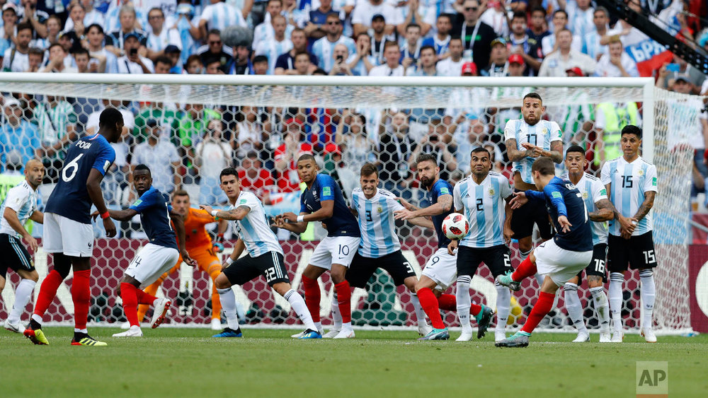 France's Antoine Griezmann takes a free kick during the round of 16 match between France and Argentina, at the 2018 soccer World Cup at the Kazan Arena in Kazan, Russia, Saturday, June 30, 2018. (AP Photo/David Vincent)