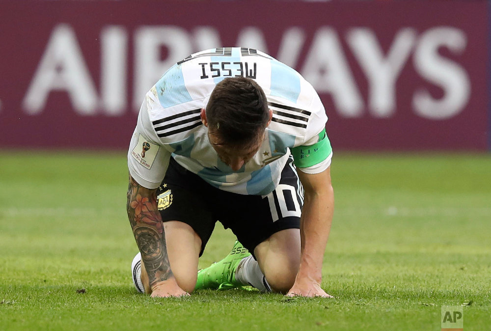 Argentina's Lionel Messi kneels on the pitch during the round of 16 match between France and Argentina, at the 2018 soccer World Cup at the Kazan Arena in Kazan, Russia, Saturday, June 30, 2018. (AP Photo/Thanassis Stavrakis)