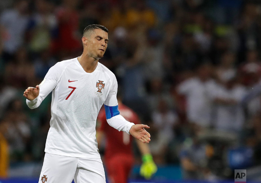 Portugal's Cristiano Ronaldo reacts after his team conceded second goal during the round of 16 match between Uruguay and Portugal at the 2018 soccer World Cup at the Fisht Stadium in Sochi, Russia, Saturday, June 30, 2018. (AP Photo/Themba Hadebe)
