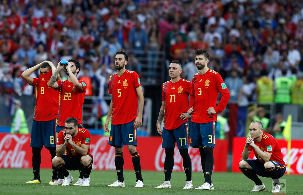 Spain's Andres Iniesta, right, watches with teammates after Spain were defeated in a penalty shoot out by Russia in the round of 16 match between Spain and Russia at the 2018 soccer World Cup at the Luzhniki Stadium in Moscow, Russia, Sunday, July 1, 2018. (AP Photo/Manu Fernandez)