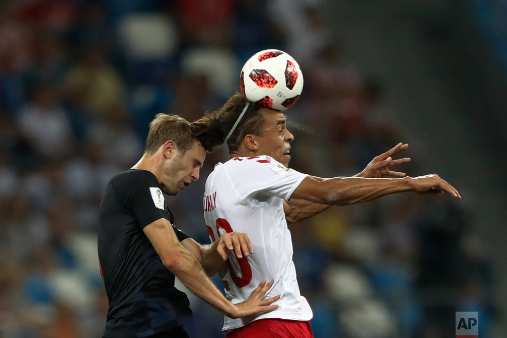 Denmark's Yussuf Yurary Poulsen, right, goes for a header with Croatia's Ivan Strinic during the round of 16 match between Croatia and Denmark at the 2018 soccer World Cup in the Nizhny Novgorod Stadium, in Nizhny Novgorod , Russia, Sunday, July 1, 2018. (AP Photo/Darko Bandic)