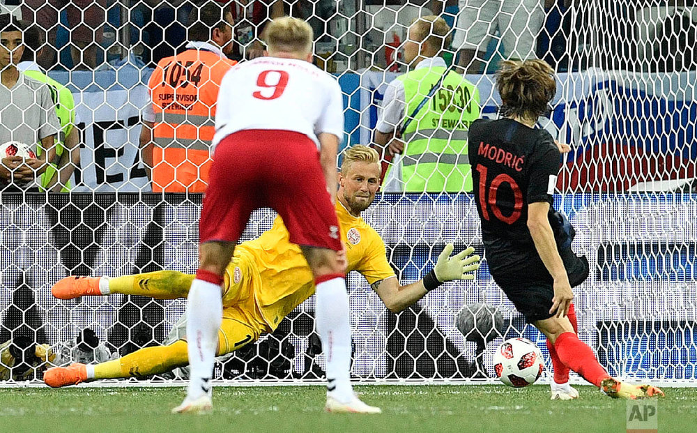 Denmark goalkeeper Kasper Schmeichel saves the penalty kick by Croatia's Luka Modric during the round of 16 match between Croatia and Denmark at the 2018 soccer World Cup in the Nizhny Novgorod Stadium, in Nizhny Novgorod , Russia, Sunday, July 1, 2018. (AP Photo/Martin Meissner)