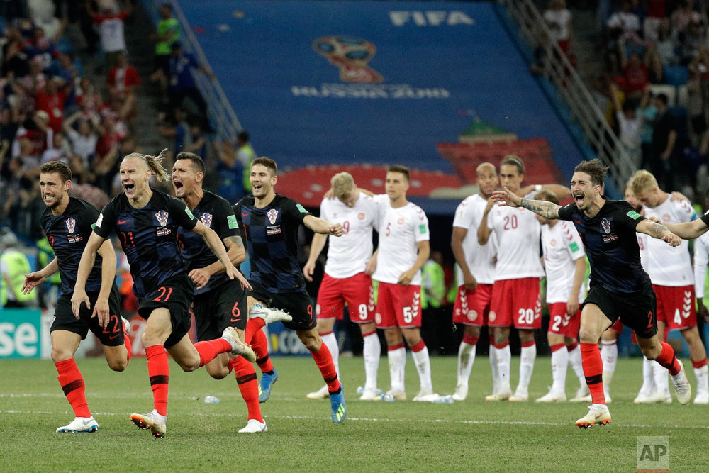 Croatians players celebrate after the penalties during the round of 16 match between Croatia and Denmark at the 2018 soccer World Cup in the Nizhny Novgorod Stadium, in Nizhny Novgorod, Russia, Sunday, July 1, 2018. Croatia eliminates Denmark 3-2 on penalties after game ends 1-1. (AP Photo/Gregorio Borgia)