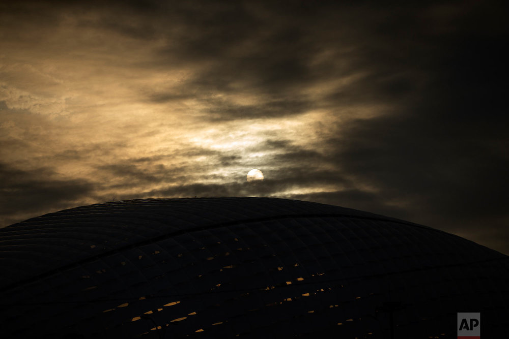 The sun shines through the clouds above the Fisht Stadium at the 2018 soccer World Cup in Sochi, Russia on June 29, 2018. (AP Photo/Francisco Seco)