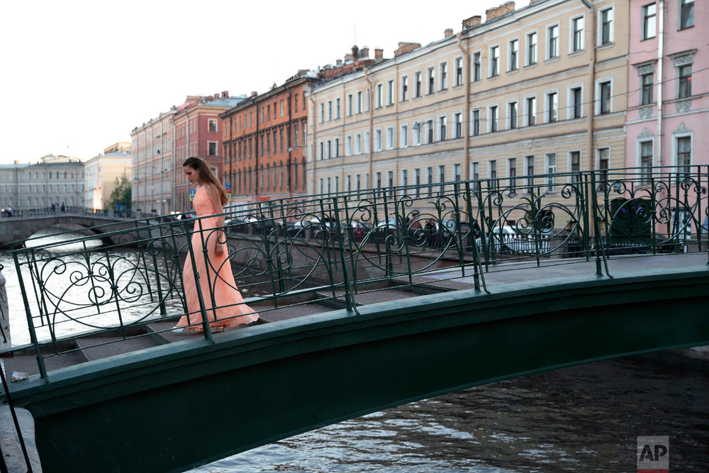 A woman crosses a bridge during the 2018 soccer World Cup in St. Petersburg, Russia on June 25, 2018. (AP Photo/Ricardo Mazalan)