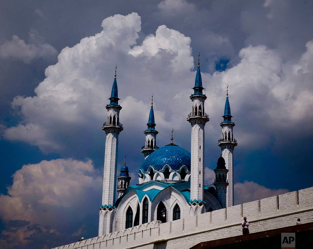 Clouds hang over the Grand Mosque of the Kremlin during the 2018 soccer World Cup in Kazan, Russia on June 26, 2018. (AP Photo/Michael Probst)