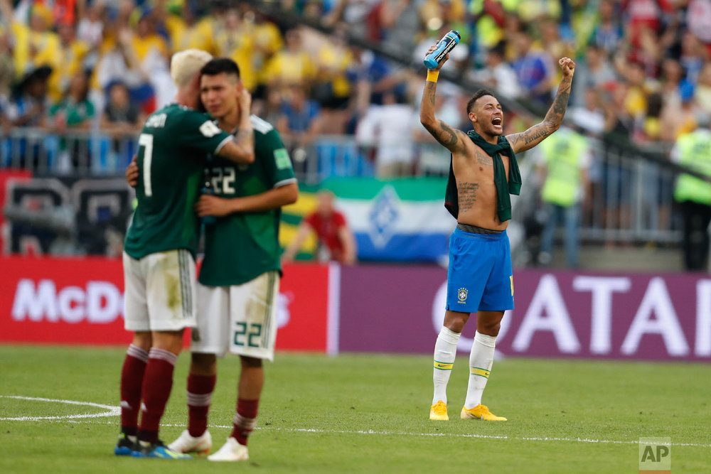 Brazil's Neymar celebrates as Mexico's Miguel Layun and teammates Hirving Lozano embrace at the end of their round of 16 match at the 2018 soccer World Cup in the Samara Arena, in Samara, Russia, Monday, July 2, 2018. Brazil won 2-0. (AP Photo/Eduardo Verdugo)
