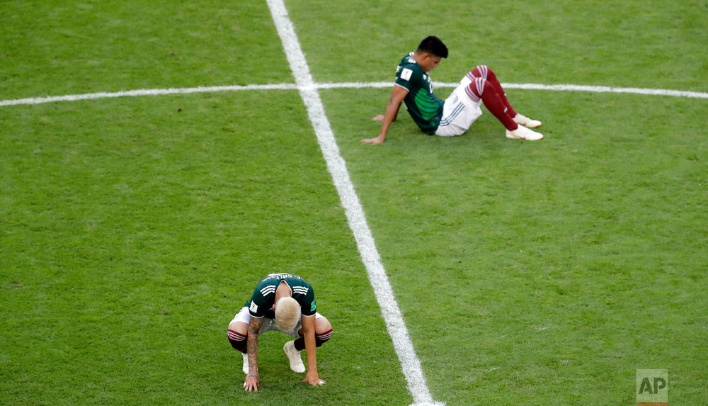 Mexico players react at the end of the round of 16 match between Brazil and Mexico at the 2018 soccer World Cup in the Samara Arena, in Samara, Russia, Monday, July 2, 2018. Brazil won 2-0. (AP Photo/Sergei Grits)