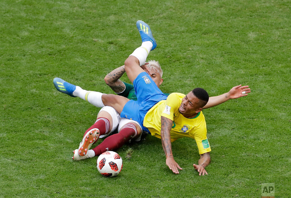 Brazil's Gabriel Jesus, right, challenges for the ball with Mexico's Carlos Salcedo during the round of 16 match between Brazil and Mexico at the 2018 soccer World Cup in the Samara Arena, in Samara, Russia, Monday, July 2, 2018. (AP Photo/Sergei Grits)