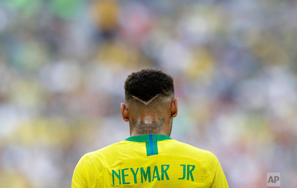 Brazil's Neymar walks on the pitch during the round of 16 match between Brazil and Mexico at the 2018 soccer World Cup in the Samara Arena, in Samara, Russia, Monday, July 2, 2018. (AP Photo/Andre Penner)